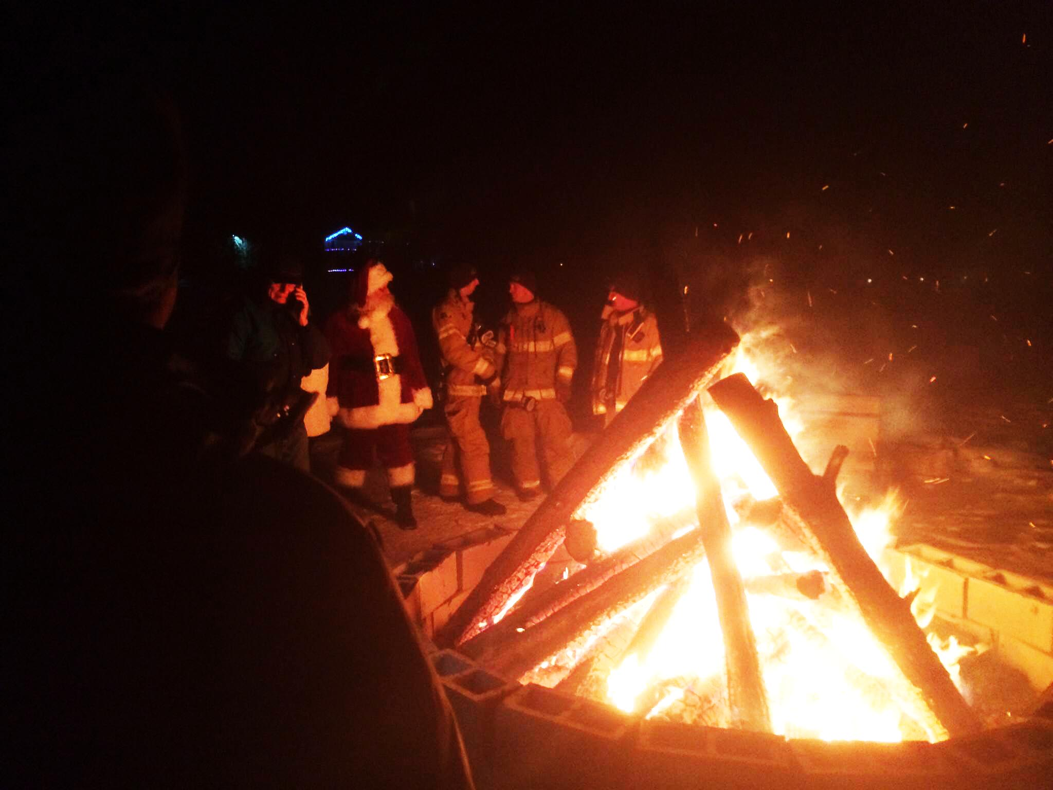 Santa Clause, firemen and bonfire