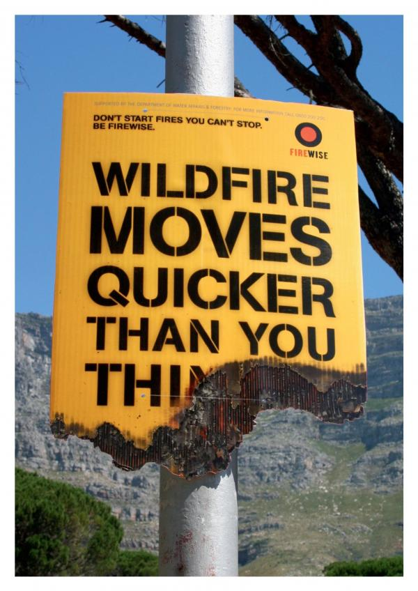 Wildfire Moves Quicker Than You Think sign